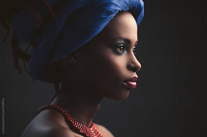 African Woman With a Blue Turban by Lumina for Stocksy United