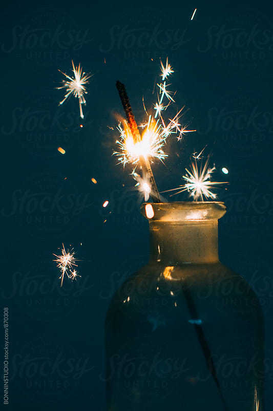 Sparkler burning in a jar. by BONNINSTUDIO for Stocksy United