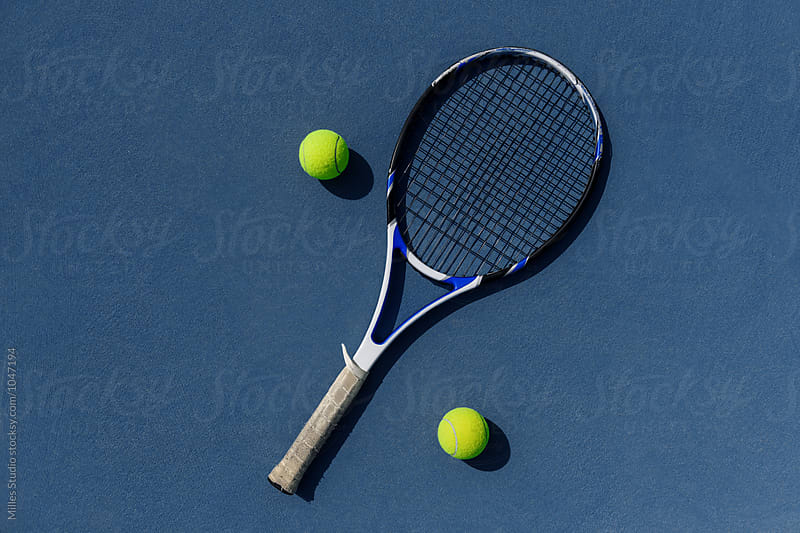 Tennis racket and two balls by Milles Studio for Stocksy United
