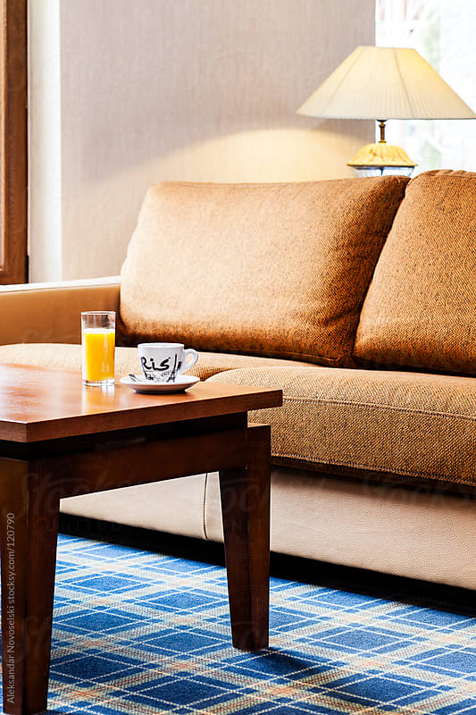 Drinking orange juice and coffee in luxury hotel interior by Aleksandar Novoselski for Stocksy United