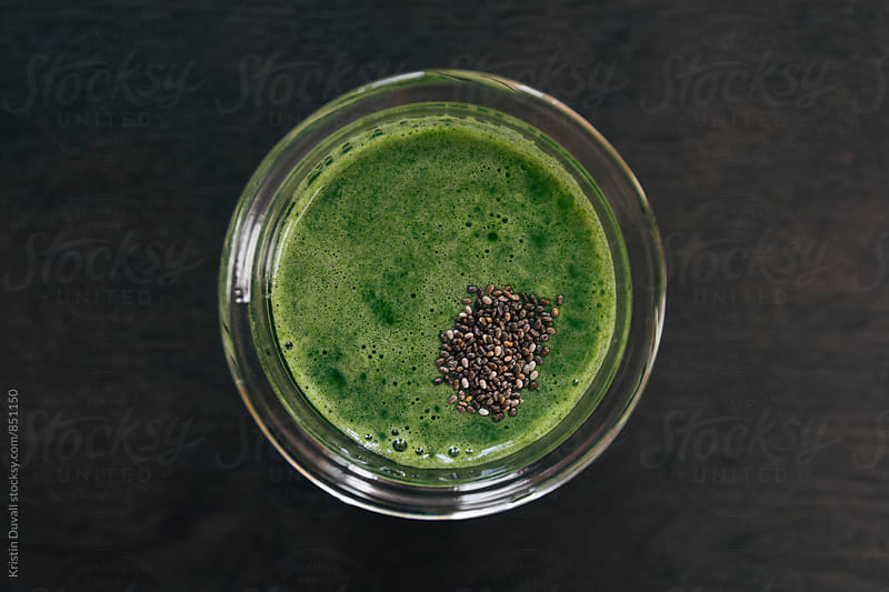 Green juice with chia seeds by Kristin Duvall for Stocksy United