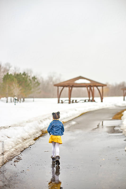 Little Girl Walks in the Park by suzanne clements for Stocksy United