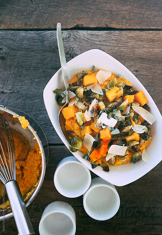 Polenta: Bowl Of Pumpkin Polenta With Brussels Sprouts And Parmesan by Sean Locke for Stocksy United