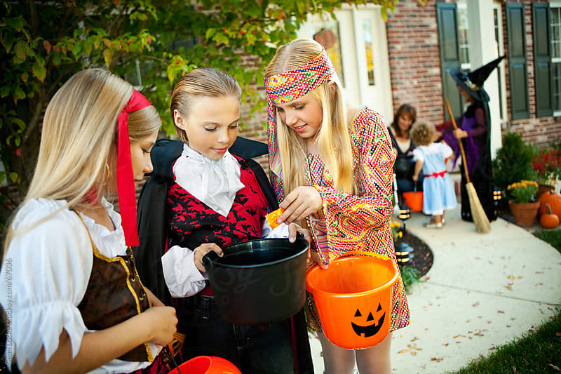 Halloween: Kids Looking to Trade Halloween Candy by Sean Locke for Stocksy United