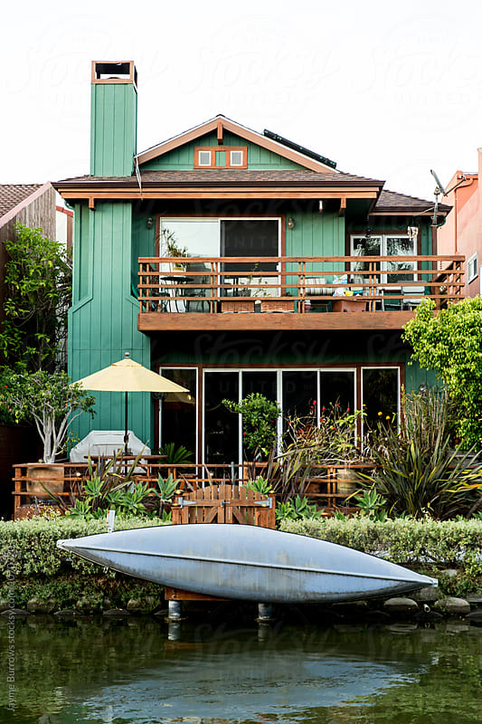 Home with Kayak on the Famous Canals of Venice, California by Jayme Burrows for Stocksy United