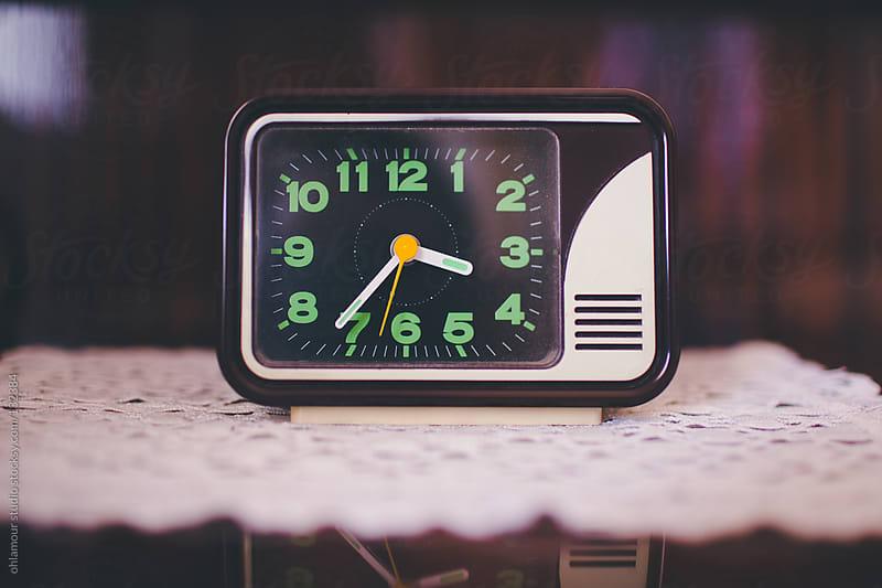 bedside old vintage clock by Leandro Crespi for Stocksy United