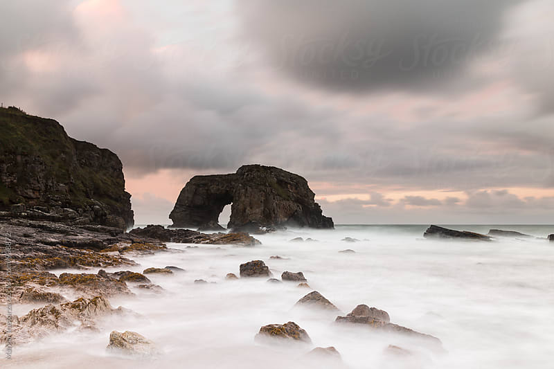 Beautiful sea arch on the irish coast by Marilar Irastorza for Stocksy United