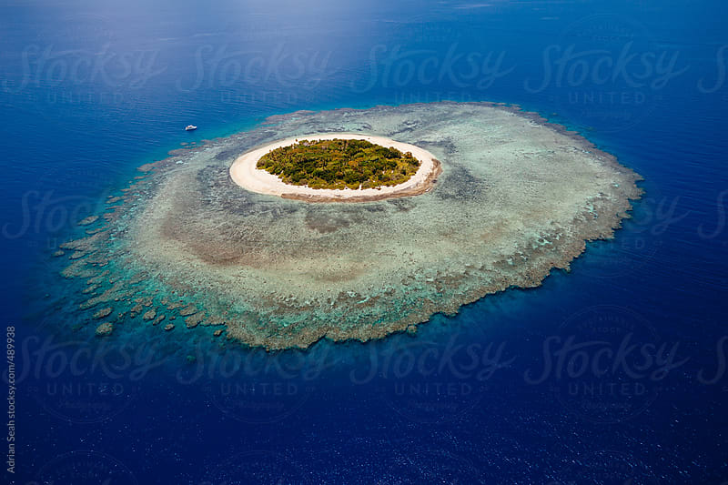 Perfectly round tropical island in Fiji by Adrian Seah for Stocksy United