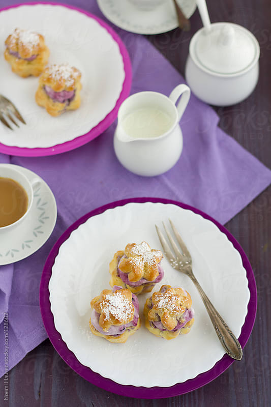 Cream puffs with blackberry whipped cream by Noemi Hauser for Stocksy United
