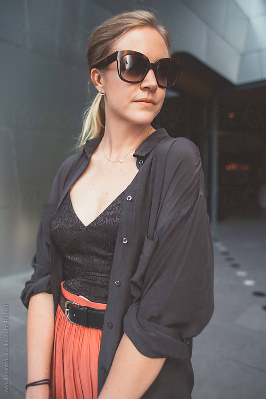 Elegant young  woman wearing designer clothes and sunglasses by Jovo Jovanovic for Stocksy United