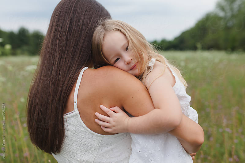 A mother and daughter embrace by Amanda Worrall for Stocksy United