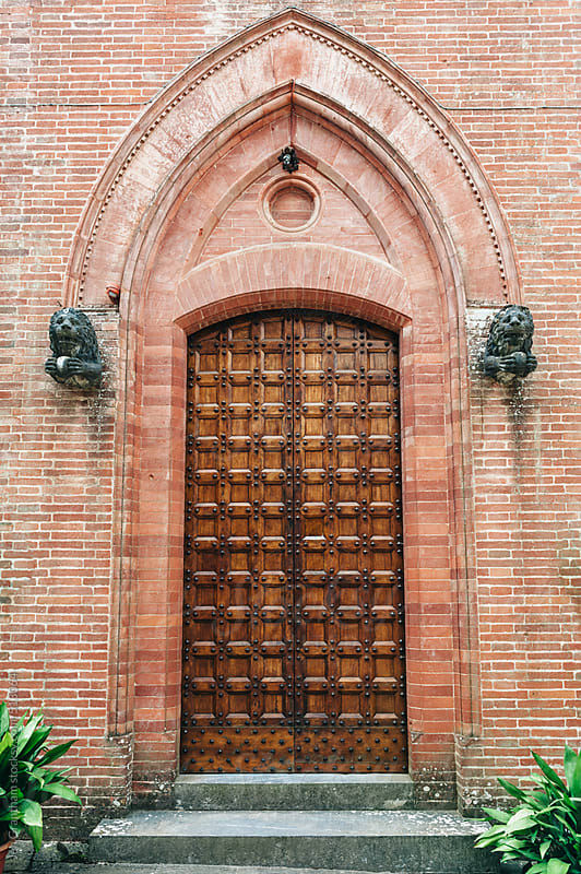 Ornate wooden door in Italy. by Jen Grantham for Stocksy United