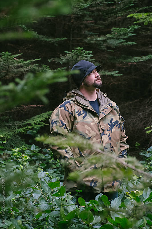 Veteran standing in nature by Shelly Perry for Stocksy United