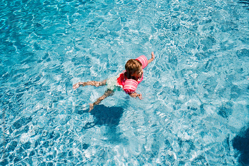 kids at pool by Maria Manco for Stocksy United