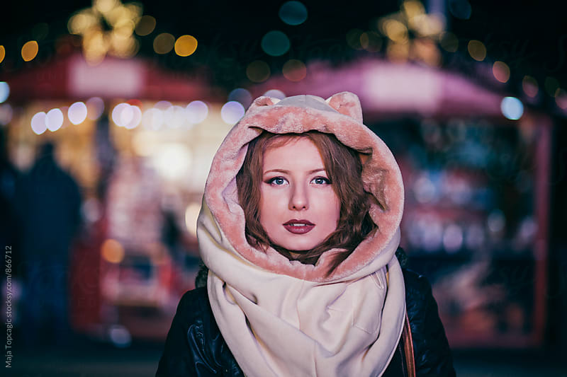 Beautiful young woman wearing cute hat with cat ears by Maja Topcagic for Stocksy United