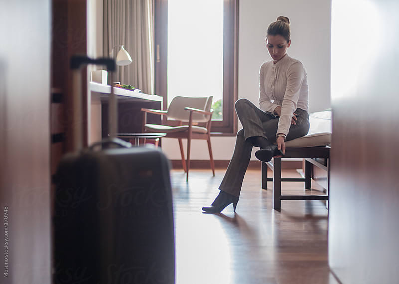 Tired Businesswoman in a Hotel Room by Mosuno for Stocksy United
