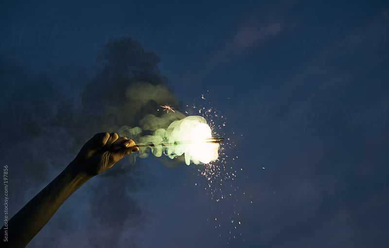Fireworks: Hand Holding Sparkler To Celebrate by Sean Locke for Stocksy United