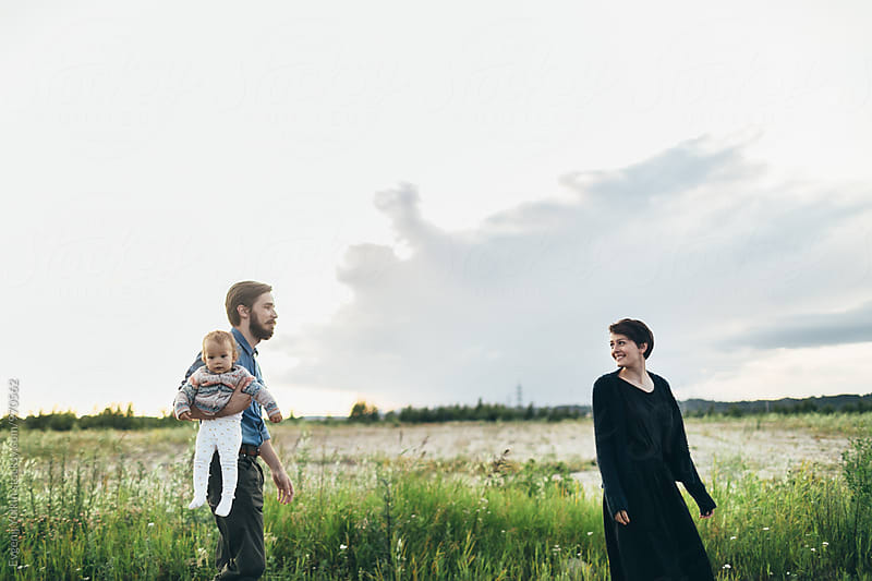 Happy family walking through countrys ide by Evgenij Yulkin for Stocksy United