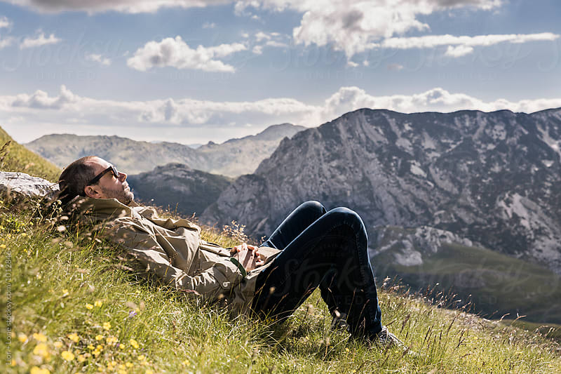 Young man resting in nature. Durmitor, Montenegro by Lior + Lone for Stocksy United