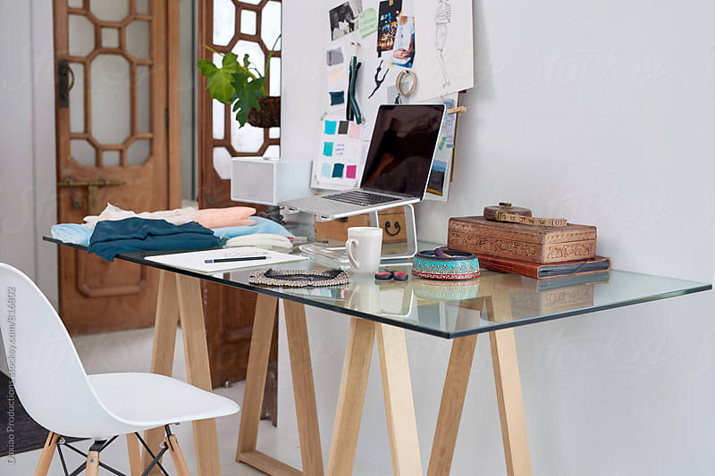 work space desk of fashion designer  by Daxiao Productions for Stocksy United