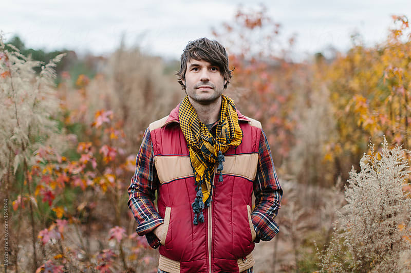 Portrait of a stylish man standing outside in nature by Jakob for Stocksy United