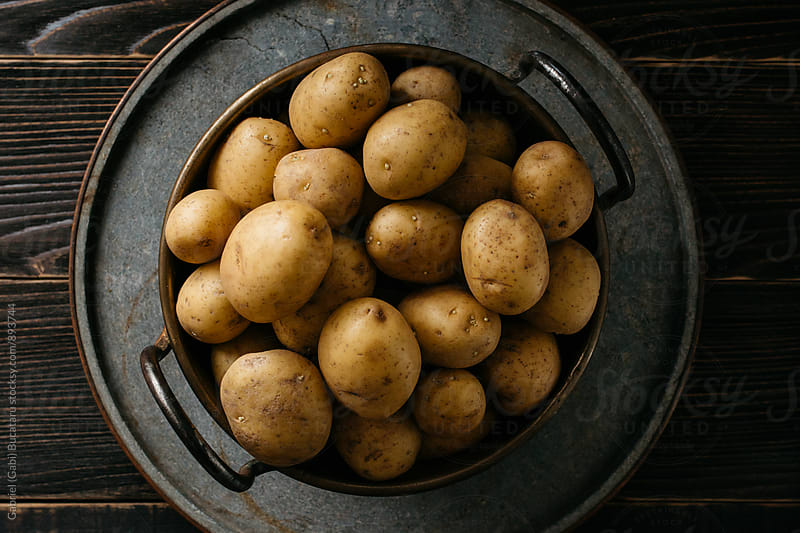 Potatoes on a bowl from above by Gabriel (Gabi) Bucataru for Stocksy United