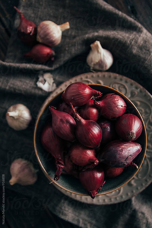 Shallots in a bowl by Nataša Mandić for Stocksy United
