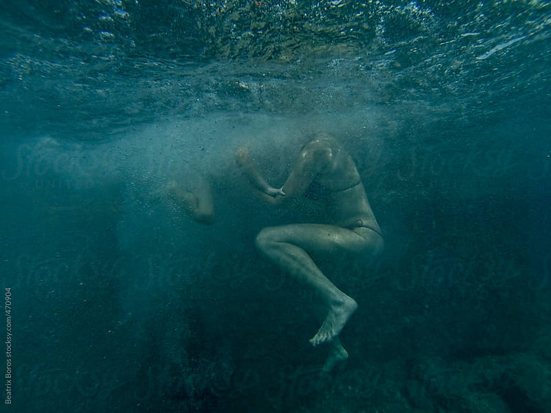 Anonym photo of a mother and a little boy underwater by Beatrix Boros for Stocksy United