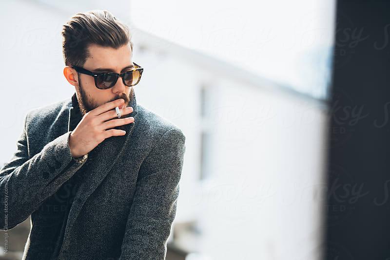 Man With Beard Smoking Outdoors by Nemanja Glumac for Stocksy United