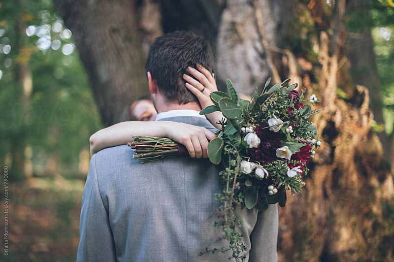 Bride and Groom Couple Embracing During Autumn Wedding by Briana Morrison for Stocksy United