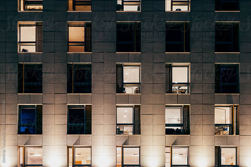 Office building at night. Late night work by Dimitrije Tanaskovic for Stocksy United