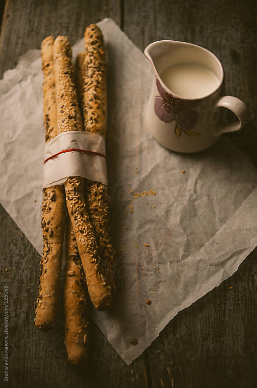 Sticks With Sesame and Milk on the Table by Branislav Jovanovic for Stocksy United
