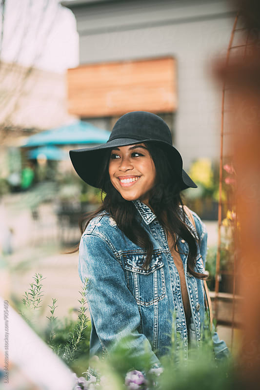 Smiling Young Woman In Sun Hat by Luke Mattson for Stocksy United