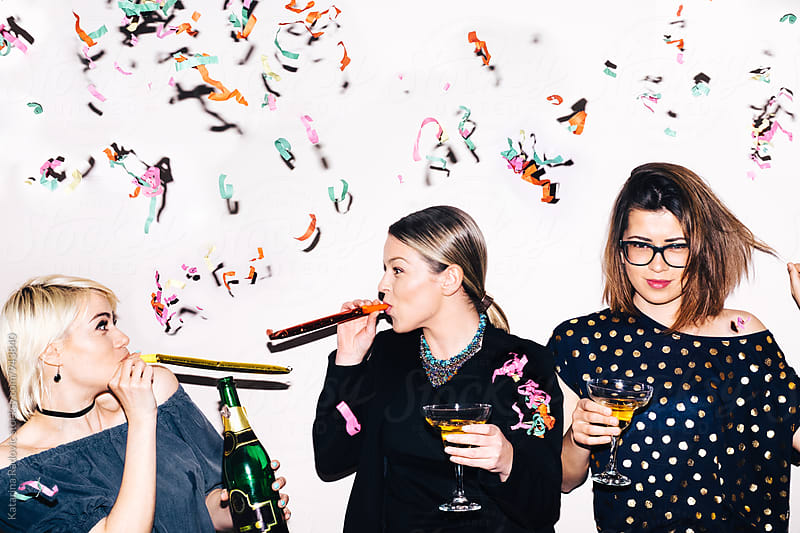 Three Party Girls Having a Good Time by Katarina Radovic for Stocksy United