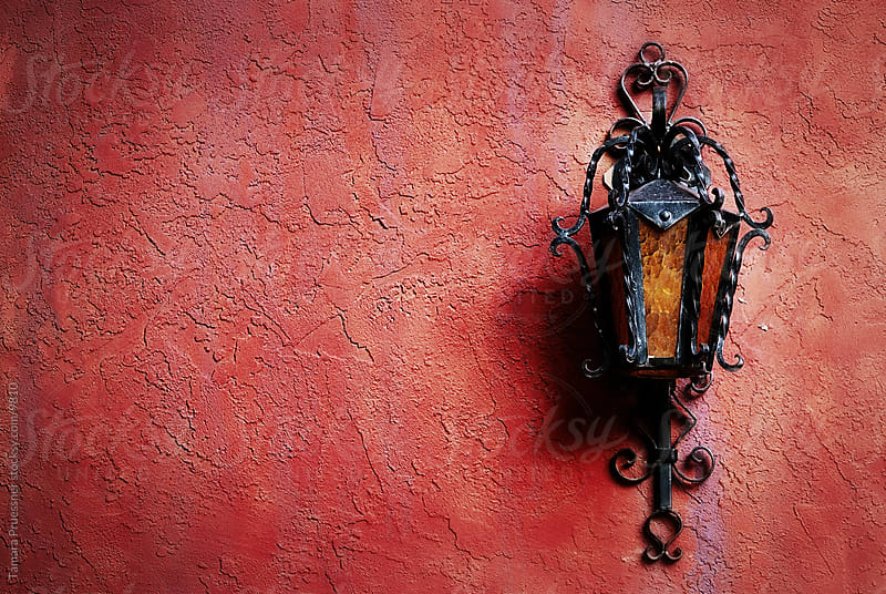 Lamp On Red Stucco Wall by Tamara Pruessner for Stocksy United