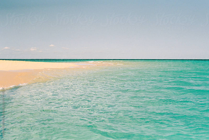A sandbank in the Indian Ocean by Helen Rushbrook for Stocksy United