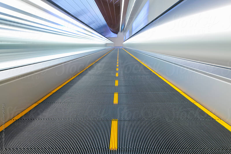View along a moving walkway in Dubai International Airport, Dubai, United Arab Emirates, UAE by Gavin Hellier for Stocksy United