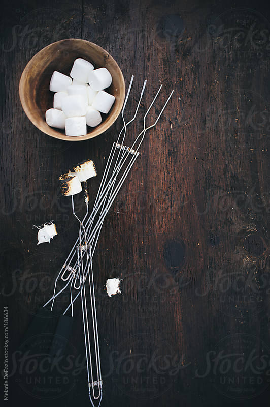 Roasted marshmallows by Melanie DeFazio for Stocksy United