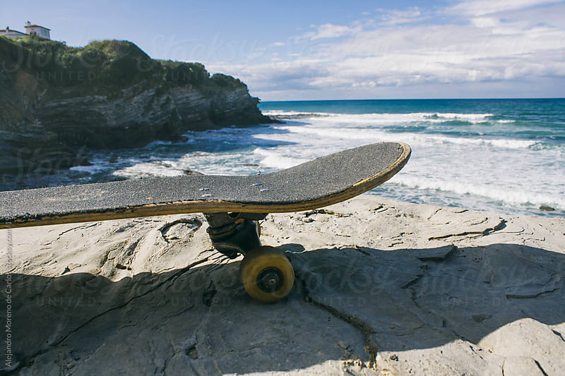 Skateboard and coast by Alejandro Moreno de Carlos for Stocksy United