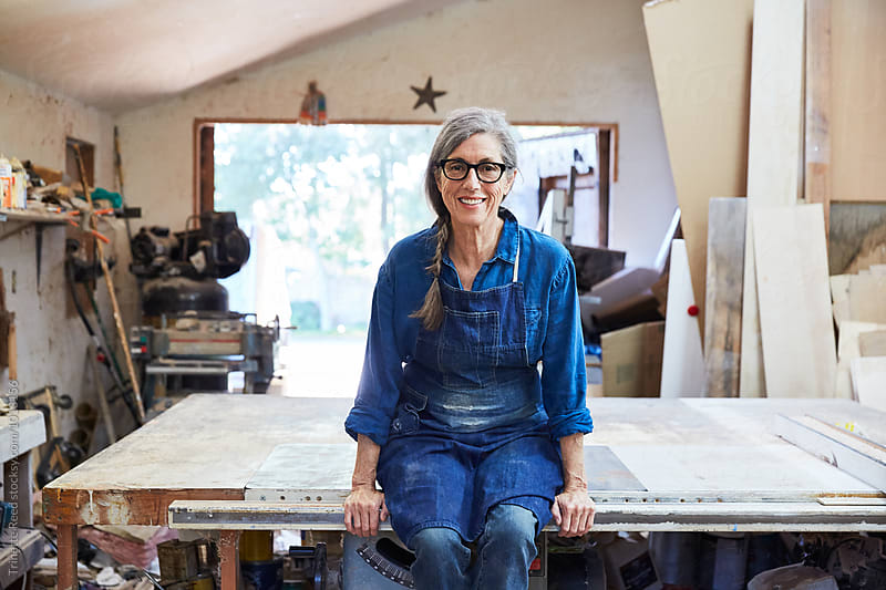 Portrait of senior woman inside her wood shop by Trinette Reed for Stocksy United