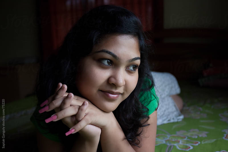 Girl relaxing on bed by Saptak Ganguly for Stocksy United