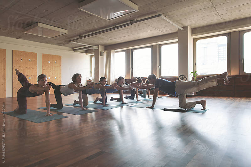 Yoga Class in Urban Yoga Studio by VISUALSPECTRUM for Stocksy United