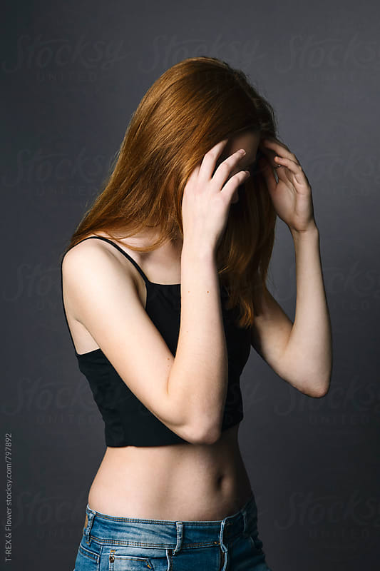 Photo of young redheaded woman  by T-REX & Flower for Stocksy United