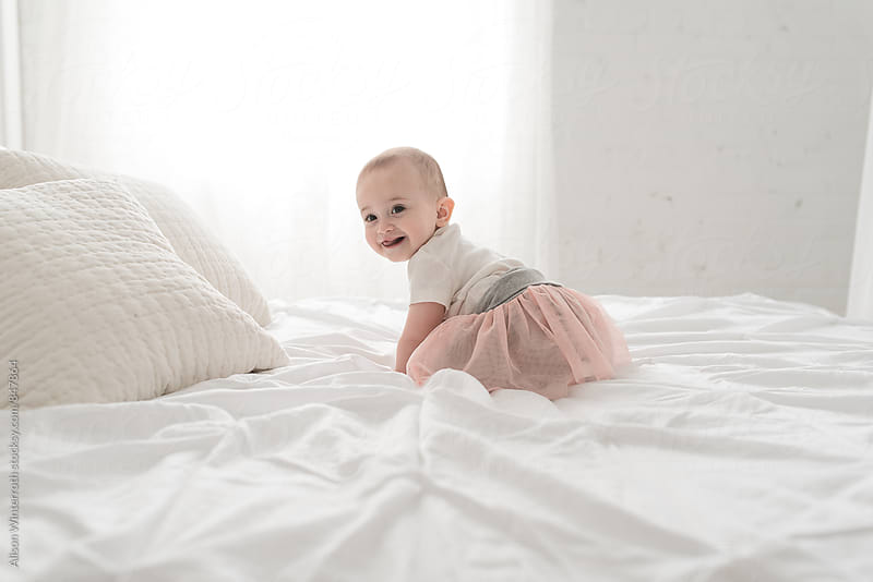 A Little Girl Crawling  And Smiling by Alison Winterroth for Stocksy United
