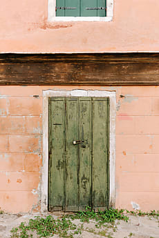 Old locked up wooden door on a building in Venice Italy by Rebecca Spencer for & Stocksy United \u2013 Premium royalty-free stock photography and ...