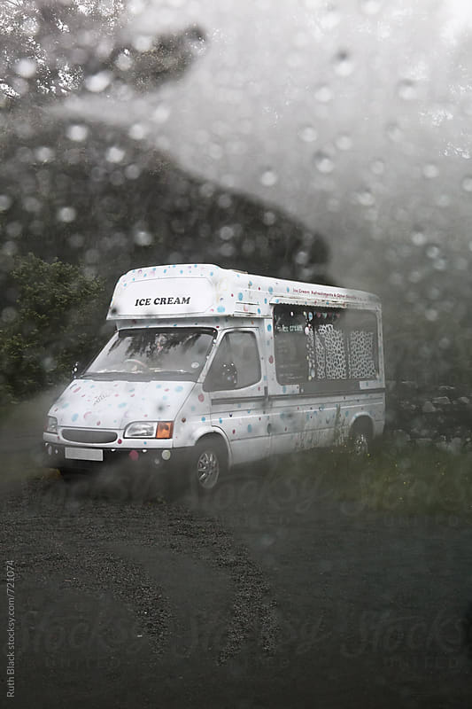 Ice cream van viewed through a rainy windscreen by Ruth Black for Stocksy United