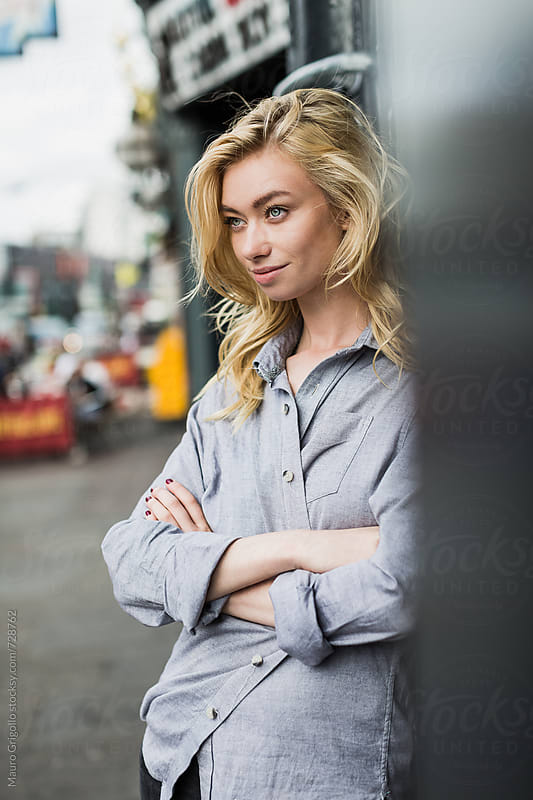 Young woman waiting for a friend in the city by Mauro Grigollo for Stocksy United