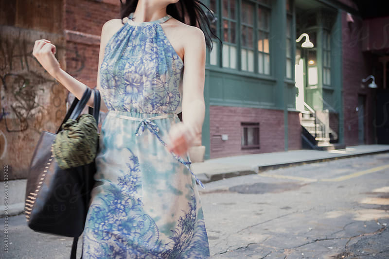 Woman in Floral Dress in Tribeca New York by Joselito Briones for Stocksy United