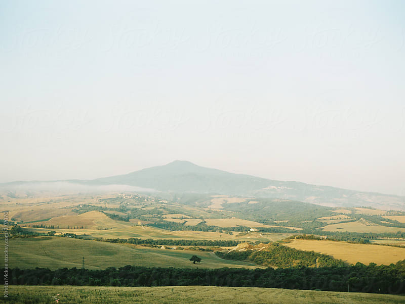 Early morning mist on Mount Amiata by Kirstin Mckee for Stocksy United