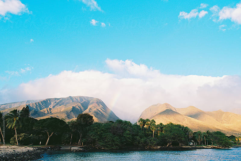 rainbow over west maui mountains on a blue sky day by wendy laurel for Stocksy United